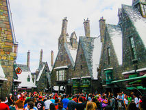 Orlando, USA - January 02, 2014: Visitors enjoying the Harry Potter themed attractions and shops at the Hogsmeade. Orlando, United States of America - January 02 Stock Images