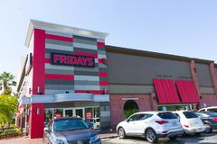 Free Orlando, USA - May 8, 2018: TGI Fridays Exterior And Logo. TGI Friday`s Is An American Restaurant Chain Focusing On Stock Images - 119199624
