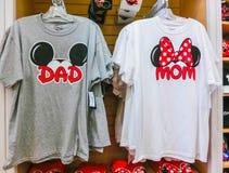 Orlando, USA - May 10, 2018: The colorful T-shirts at Disney store indoor shopping mall Orlando premium outlet at. Orlando, USA on May 10, 2018 stock photo