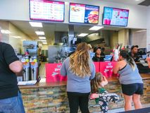 Orlando, USA - May 10, 2018: The people at famous hamburger shop WENDYS stock photo