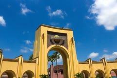 Orlando, USA - May 8, 2018: The people going to main entrance to park Universal Studios. Orlando, USA - May 8, 2018: The main entrance to park Universal Studios Stock Photo