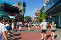 Orlando, USA - May 9, 2018: The Universal City Walk is the mall at the entrance of the Universal Studios Orlando. Orlando, USA - May 9, 2018: The people going at Stock Images