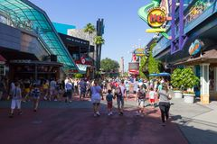 Orlando, USA - May 9, 2018: The Universal City Walk is the mall at the entrance of the Universal Studios Orlando. Orlando, USA - May 9, 2018: The people going at Stock Photos