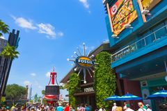 Orlando, USA - May 9, 2018: The Universal City Walk is the mall at the entrance of the Universal Studios Orlando. Orlando, USA - May 9, 2018: The people going at Stock Photography