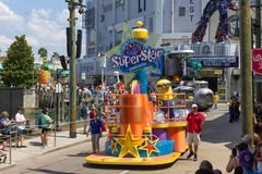 Orlando, USA - May 8, 2018: The large parade with performers at Universal Studio park on May 8, 2018. Orlando, USA - May 8, 2018: The people looking on Stock Photo