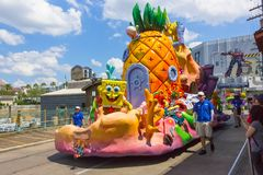 Orlando, USA - May 8, 2018: The large parade with performers at Universal Studio park on May 8, 2018. Orlando, USA - May 8, 2018: The people looking on Stock Image