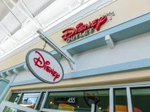 Orlando, USA - May 10, 2018: The sign for a Disney retail store indoor shopping mall Orlando premium outlet at Orlando. USA on May 10, 2018 royalty free stock image
