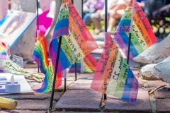 ORLANDO, USA - MAY 05, 2017: Small gay flags in the ground, place where Omar Mateen, killed 49 people and wounded 53. Others in a terrorist attack hate crime in Royalty Free Stock Photos