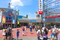 Orlando, USA - May 9, 2018: The Universal City Walk is the mall at the entrance of the Universal Studios Orlando. Orlando, USA - May 9, 2018: The people going at Royalty Free Stock Images