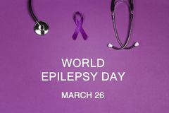 Purple epilepsy awareness ribbon with stethoscope. Orld epilepsy day. Purple epilepsy awareness ribbon with stethoscope on a purple background. W Purple Day stock photography