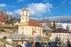 Orlicky, in Orlicke mountains. Orlicky - February 6: The facade of the church of St Jan Nepomuk on February 6, 2018 in Orlicky, Czech Republic. The north-west Royalty Free Stock Photos