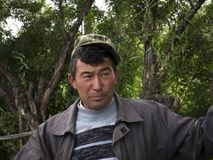 Kyrgyz peasant with cap looks questioningly royalty free stock photos