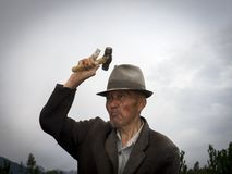 Old man with hat and injured finger royalty free stock photos