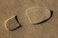 Orma in sabbia sulla spiaggia Fotografie Stock Libere da Diritti