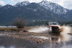 Ford Ranger pick-up  is off roading in the mud stock photo