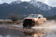 Ford Ranger pick-up  is off roading in the mud royalty free stock photos