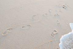 Orme in sabbia Immagini Stock