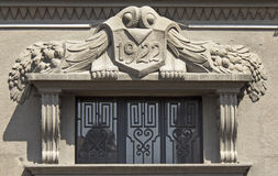 Ornament above the entrance to the building from 20 s Stock Photo