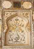 Ornament at the Amber Fort wall. Beautified wall paintings with multi mirrored glass inlaid panels in the Mirror Palace or Sheesh Mahal at Amber Fort stock images