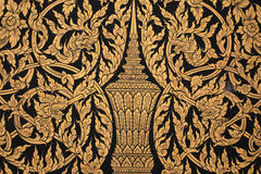 Ornament: Ancient Thai craft pattern on wall Stock Photo