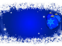 Ornament background. Snowflake border on dark blue with three Christmas ornaments Stock Photography
