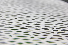 The ornament on the background. The perforated patterns on the metal sheet Stock Photos