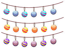 Ornament balls hanging on ropes Stock Photography