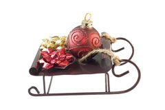 Ornament and bows on sleigh Stock Photo