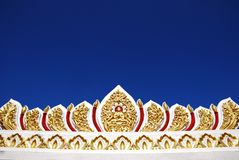Ornament of the Buddhist temple in Bangkok, Thailand. Picture with copy space. Beautiful clear blue sky Royalty Free Stock Photo