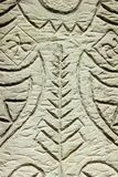 Ornament carved in stone. On the gray stone cutting out pattern in ethnic style Royalty Free Stock Images