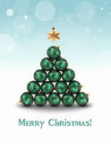 Ornament Christmas Tree. Abstract illustration: Green ornaments and a golden star topper are building a christmas tree on a light blue bokeh background Royalty Free Stock Photo