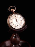 Ornament decorated gold and silver old pocket watch on wooden stand Royalty Free Stock Photos