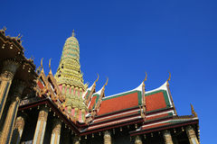 Ornament: detailed shrine architecture. Against blue sky at Wat Phra Kaew in Bangkok, Thailand Stock Photos