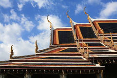 Ornament: detailed temple roof against blue sky Stock Photos