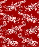 Ornament of the dragons. Pattern of Chinese dragons white on red background Stock Images