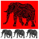 Ornament elephant. Plack eliphant with ornament on a red background Stock Photography