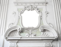 The ornament of a fireplace hood in a neo classical villa suitab Royalty Free Stock Photography
