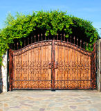 Ornament forged big iron garden gate Royalty Free Stock Photo