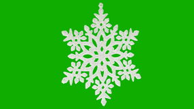 Ornament in the form of a snowflake on a green stock footage
