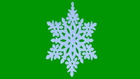 Ornament in the form of a snowflake on a green Royalty Free Stock Images