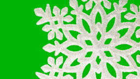 Ornament in the form of a snowflake on a green Royalty Free Stock Photography