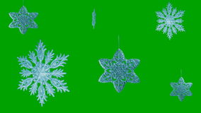 Ornament in the form of a snowflakes on a green stock video
