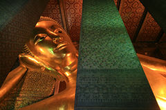 Ornament: giant reclining gold buddha in Wat Pho Stock Photography