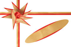 Ornament for a gift from a band. The beautiful bow from a beige and red band decorates a gift Stock Images