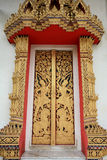 Ornament: Gold art pattern on temple door Royalty Free Stock Photos