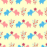 The ornament of a loving couple of elephants, flowers and hearts. Seamless pattern for kids. Vector illustration. Blue, pink, red, brown, light yellow stock illustration