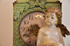 Ornament of the old clock and angel. Scene of the ornament of the old clock and angel Royalty Free Stock Photo