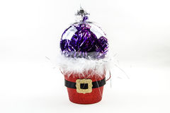 Ornament in a pail. A clear ornament sitting in a Santa Claus pail Stock Images