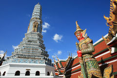 Ornament: red giant guardian and shrine. Architecture at Wat Phra Kaew in Bangkok, Thailand Stock Photo