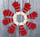 Ornament with red gloves on wooden background. Christmas, winter Royalty Free Stock Photo